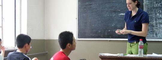 A teacher addresses her class