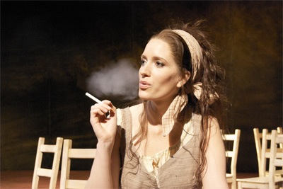 Opera singer smoking an electronic cigarette.