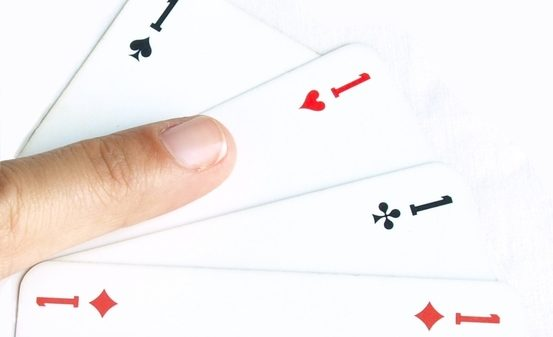 cards-pointing-to-the-ace-of-hearts-1307084