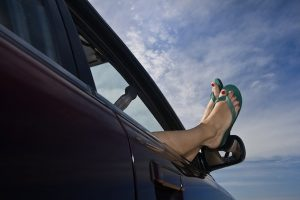 Relaxed Person Hangs Flip Flops Out The Car Window