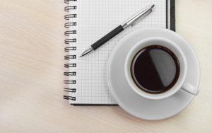 Notepad and coffee - a writing habit